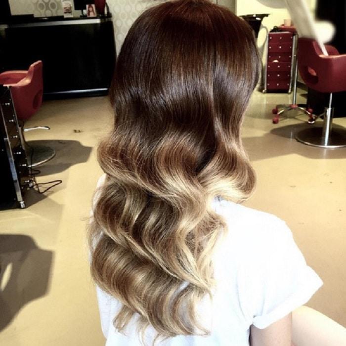 peinados pelo largo suelto con ondas retro
