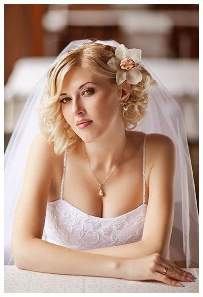 peinados para novias con velo con orquidea